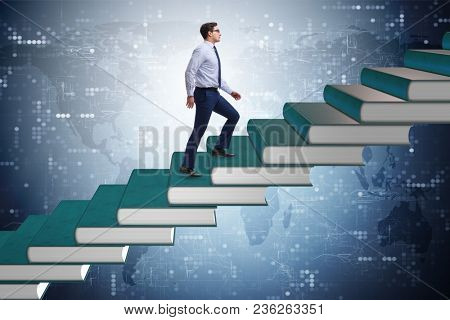 Businessman student climbing the ladder of education books