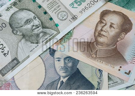 Pile Of Asian Leading Countries New Emerging Market Money Banknotes, Indian Rupee, Chinese Yuan And