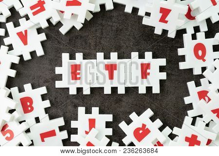 Etf, Exchange Traded Fund Concept, White Puzzle Jigsaw With Alphabet Etf At The Center, A Type Of In