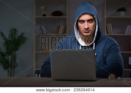 Hacker hacking the data late at night