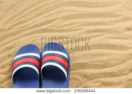 Close Up Blue Sandals On Sand Of Beach, Summer Concept