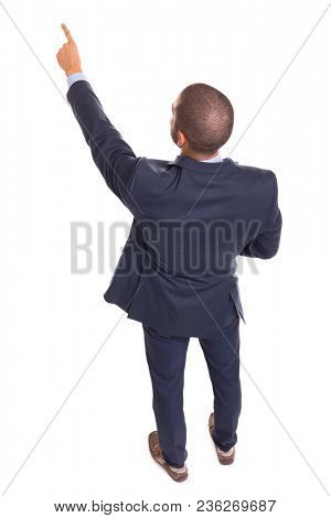 Top view of a business man pointing to copyspace, isolated on a white background