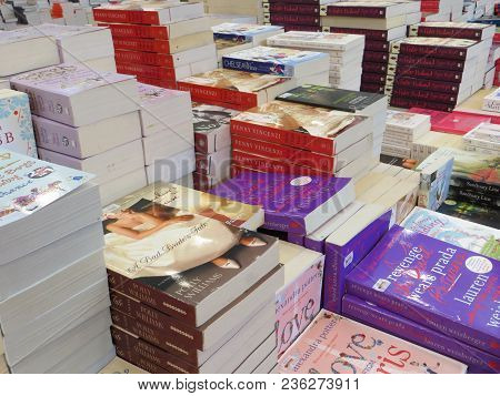 Tangerang, Indonesia - April 22, 2017: Stacks Of Fiction Books For Sale On Books Fair At Ice Bsd Cit