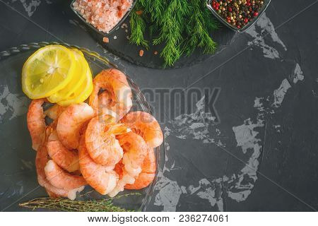 Frozen Cooked Shrimp To Cooking With Lemon Dill And Spices. Close Up. Selective Focus. Copy Spase