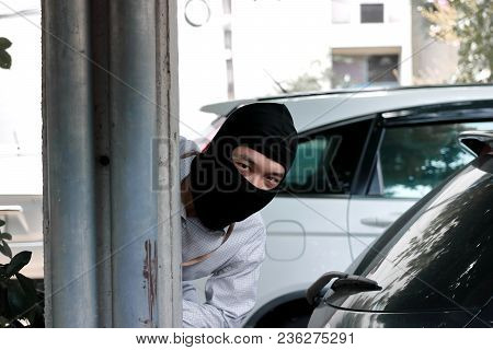 Thief In Black Balaclava Trying To Break Into Car