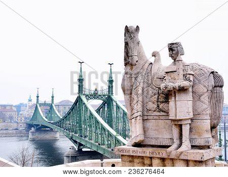 Liberty Bridge And Statue Of St Stephen I, Budapest, Hungary.