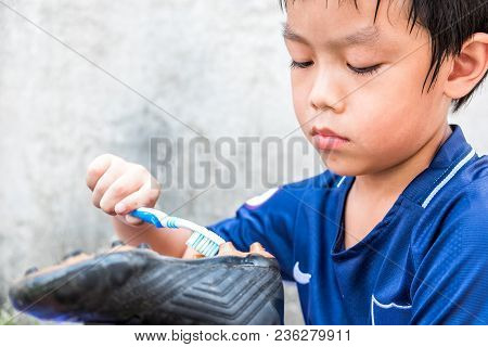 A Boy Is Cleaning His Stud After The Match. He Understand This Is His Responsibility.