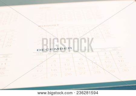 Closeup Desk Calendar Page Focus On December, Blurred The Months Pass, Weekly Start On Sunday. Vinta