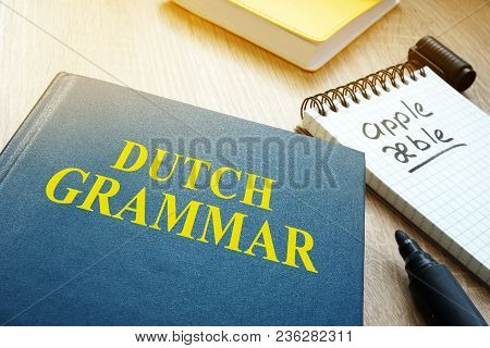 Learn Dutch Grammar. Book And Pen A Table.