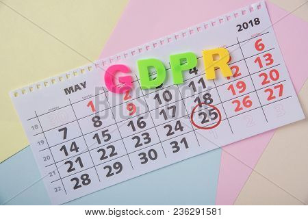 General Data Protection Regulation On A Colored Paper Background And A Calendar With The Date May 25