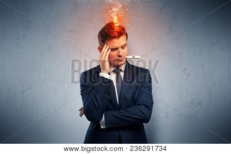 Fever businessman with burning head concept
