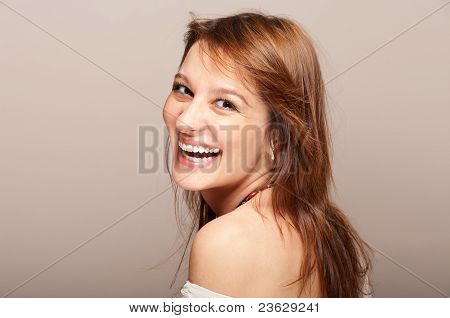 Portrait Of Laughing Redhead Woman Turning Around