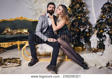 A Loving Couple Enjoy Each Other On New Year's Eve. Handsome Man And Beautiful Woman In Elegant Even