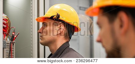 Closeup Of Electrician Engineer Works With Electric Cable Wires