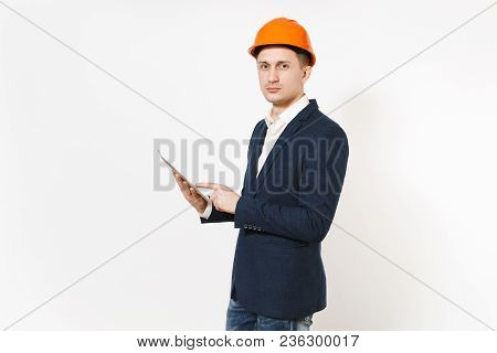 Young Handsome Successful Businessman In Dark Suit, Protective Construction Helmet Holding Tablet Pc