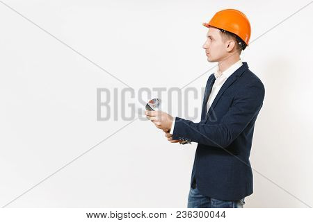 Young Handsome Businessman In Dark Suit, Protective Hardhat Holding Clipboard With Papers Document A