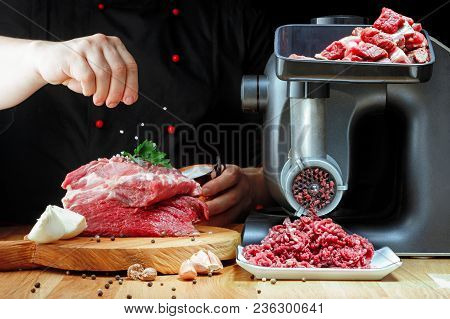Chef Solit Minced Fresh Meat On Dark Background.  Horizontal View.