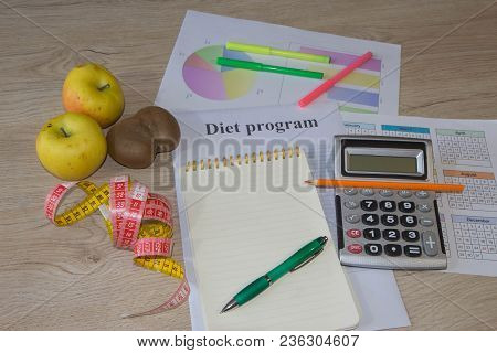 Concept Of Diet. Low-calorie Fruit Diet. Diet For Weight Loss. Notepad, Pen, Measuring Tape And Frui