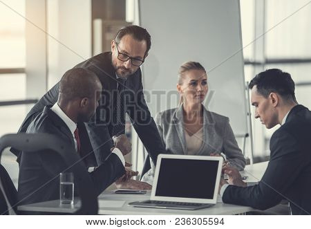 Serious Director Talking With Employee While Locating Near Him In Modern Office. Career Concept