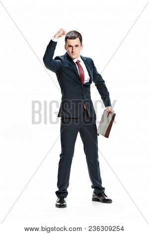 Angry Aggressive Businessman Threatening And Pointing To Camera. Isolated On White Studio Background