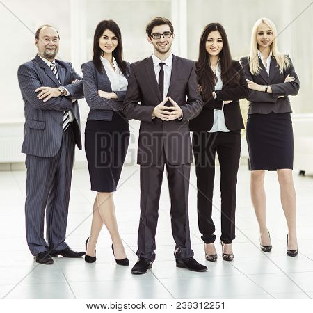 Leader Of Successful Business Team In The Background Of The Office.the Photo Has A Empty Space For Y