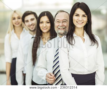 Closeup - The Leader And The Business Team Standing One Behind The Other.photo On The Background Of