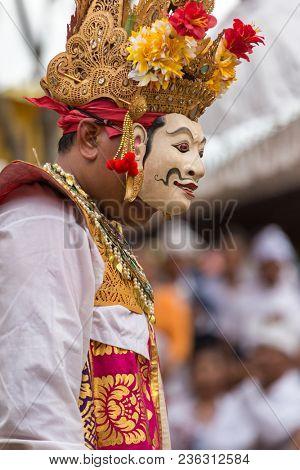 Bali, Indonesia - September 17, 2016: Unidentified balinese man performing in mask during Galungan celebration in Ubud, Bali