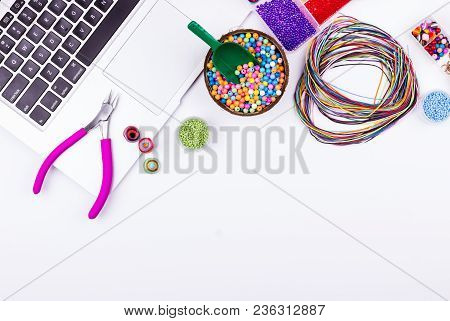 Handmade, Hobby, Craft Workspace Concept. Feminine Workplace In Flat Lay Style With Laptop And Mater