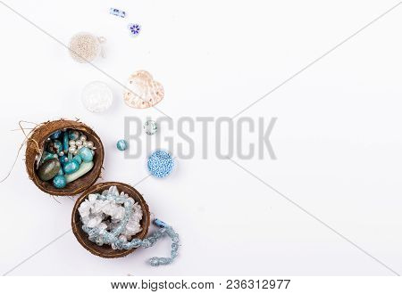 Feminine Workplace In Blue And Aqua Colours In Flat Lay Style. Gemstones, Glass Beads, Shell Beads I
