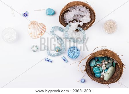 Feminine Workplace In Blue And Aqua Colores In Flat Lay Style. Gemstones, Glass Beads, Shell Beads,