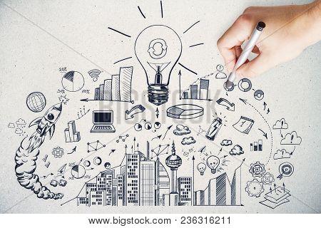 Hand Drawing Business Sketch On Concrete Wall Background. Idea And Finance Concept