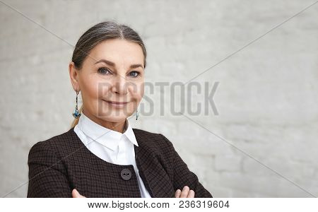 Beauty, Style, Fashion And Age Concept. Close Up Portrait Of Positive Elegant 60 Year Old Female Wit