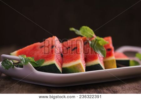 Fresh Sliced Watermelon In White Dish On Wooden Table.