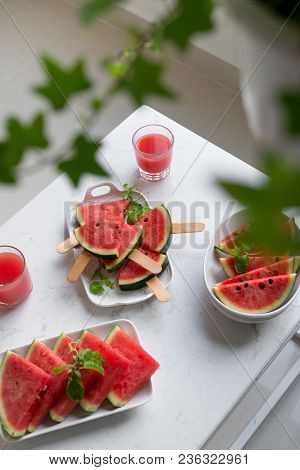 Fresh Red Smoothie In A Glass With Sliced Pieces Of Watermelon On Table.