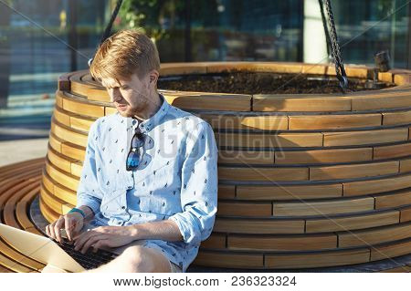 People, Leisure, Communication And Modern Technology Concept. Handsome Unshaven Young Man Wearing Su