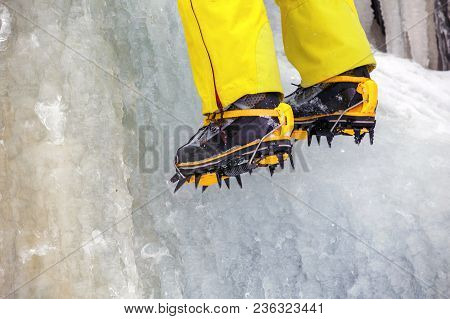 Crampons Close-up On His Feet Ice Climber, Climber On A Frozen Waterfall
