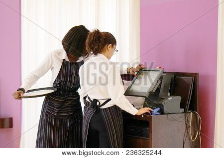 Two Waiter Places An Order At The Cash Register At The Hotel Restaurant. Service Concept