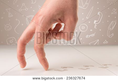 Female fingers walking on white surface with bare footsteps behind them and white scribbles in the background
