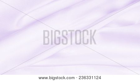 Smooth Elegant Lilac Silk Or Satin Texture As Wedding Background. Luxurious Valentine Day Background