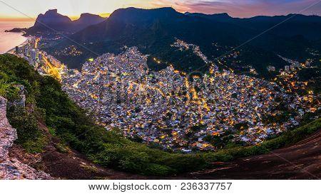 Panoramic View Of Rocinha, The Largest Favela In Rio De Janeiro City, By Evening Light