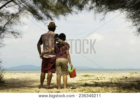 Father And Son With The Beach Or Family With The Beach.