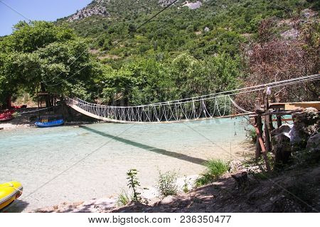 Suspension Bridge Over A Mountain Stream. Greece