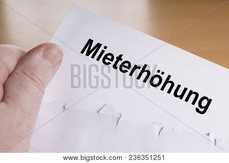 Mieterhohung Is German For Rent Increase, Hand Holding Letter