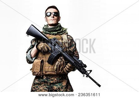 Studio Shot Of United States Marine With Rifle Weapons In Uniforms. Military Equipment, Army Helmet,
