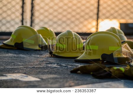 Fire Fighting Helmets Are Drying On The Navy Ship Deck After Use. Safety Net Has Seen As A Backgroun