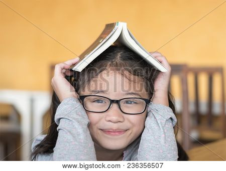 Educational Literacy, World Book Day Concept With Smart Asian School Student Girl Kid With Eyeglasse