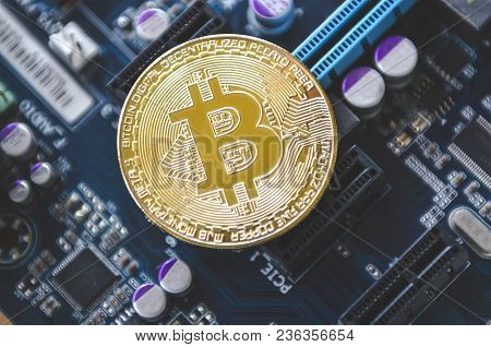 Golden Coin Symbol Bitcoin On Mother Board  Blockchain , Cryptocurrencies , Bitcoin And Distributed