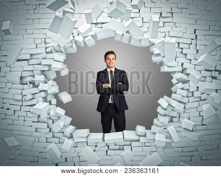 smiling businessman and brick 3d wall explosion