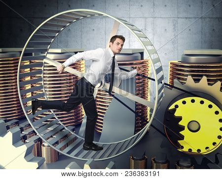businessman man run inside of hamster wheele to produce energy