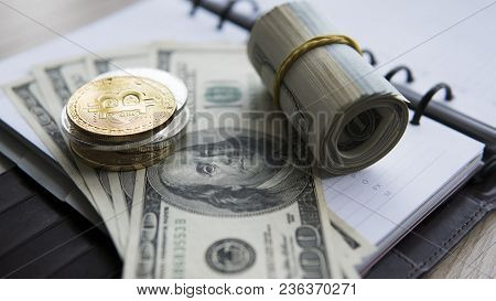Golden Bitcoins On A Us Dollar And Notebook. Bitcoin Crypto Currebcy On Us Dollars. Virtual Money. M